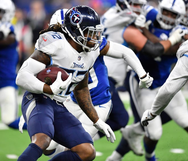 Titans running back Derrick Henry (22) gains yards in the fourth quarter against the Colts at Lucas Oil Stadium Sunday, Nov. 18, 2018, in Indianapolis, Ind.