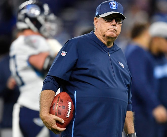 Titans defensive coordinator Dean Pees watches warm-ups Sunday at Lucas Oil Stadium.
