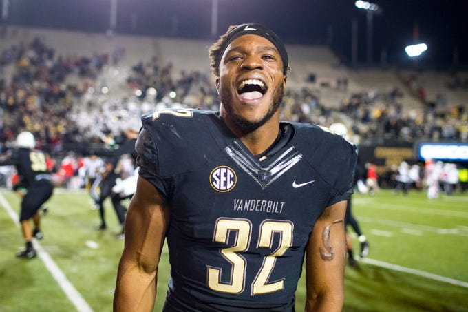 Vanderbilt running back Jamauri Wakefield (32) celebrates after Vanderbilt's game against Ole Miss at Vanderbilt Stadium in Nashville on Saturday, Nov. 17, 2018.