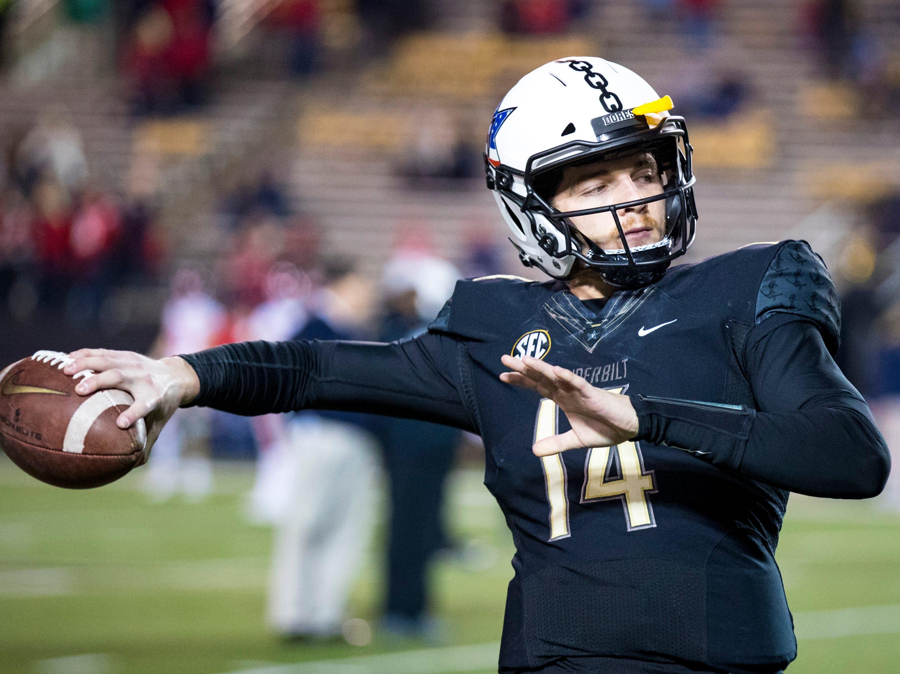 Vanderbilt quarterback Kyle Shurmur (14) warms up before Vanderbilt's game against Ole Miss at Vanderbilt Stadium in Nashville on Saturday, Nov. 17, 2018.
