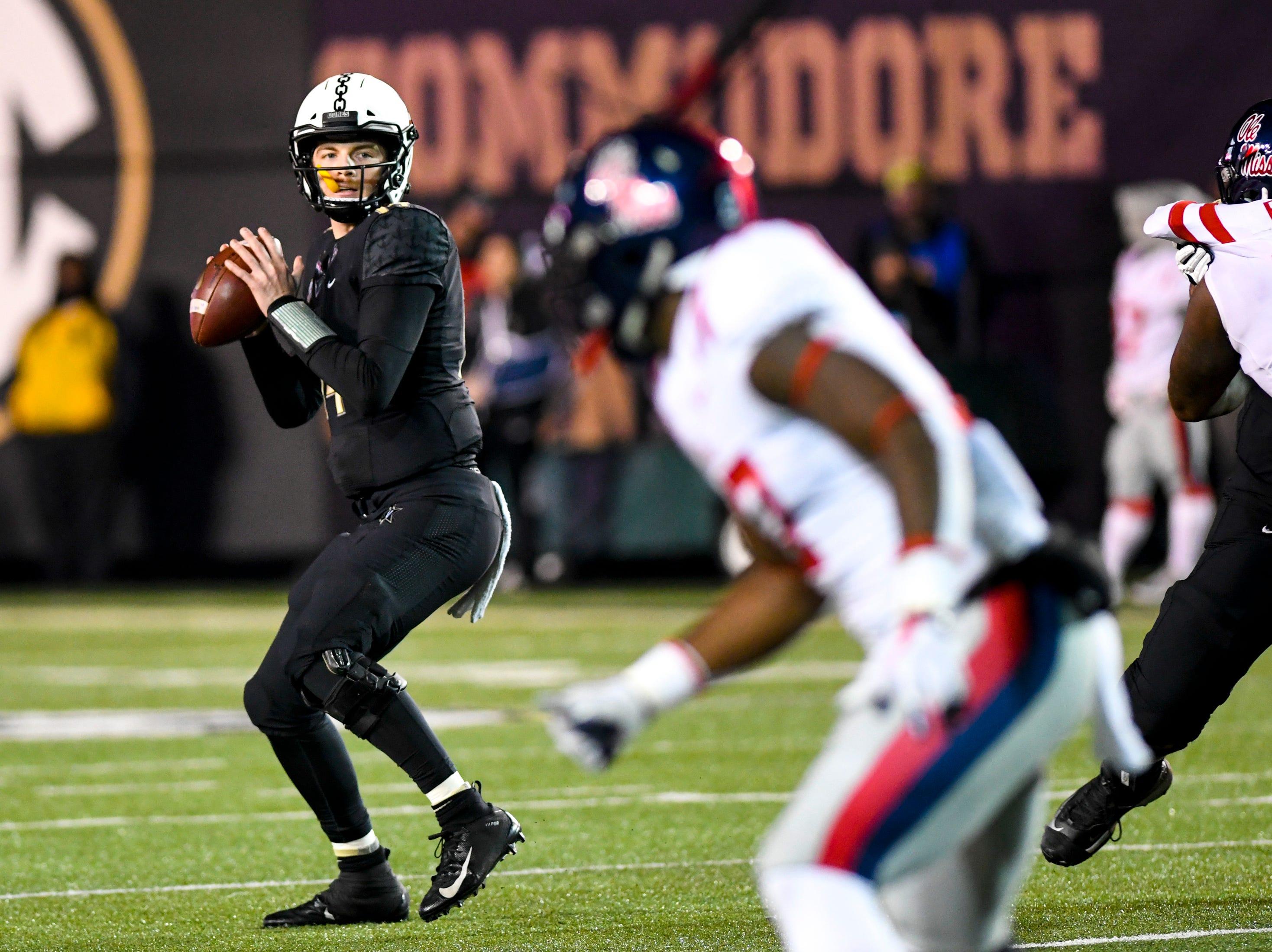Vanderbilt quarterback Kyle Shurmur (14) looks to pass during Vanderbilt's game against Ole Miss at Vanderbilt Stadium in Nashville on Saturday, Nov. 17, 2018.