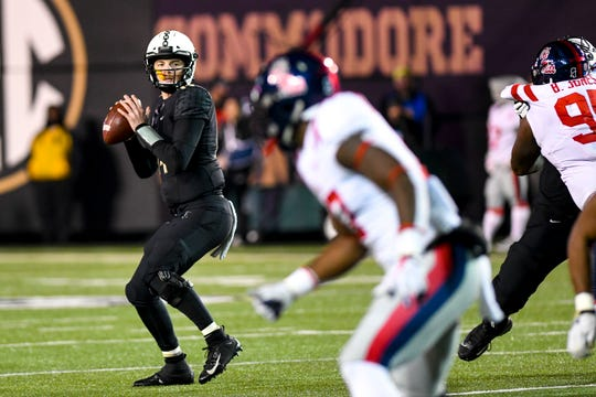 Vanderbilt quarterback Kyle Shurmur (14) looks to pass during Vanderbilt's game against Ole Miss at Vanderbilt Stadium in Nashville on Saturday, Nov. 17, 2018.