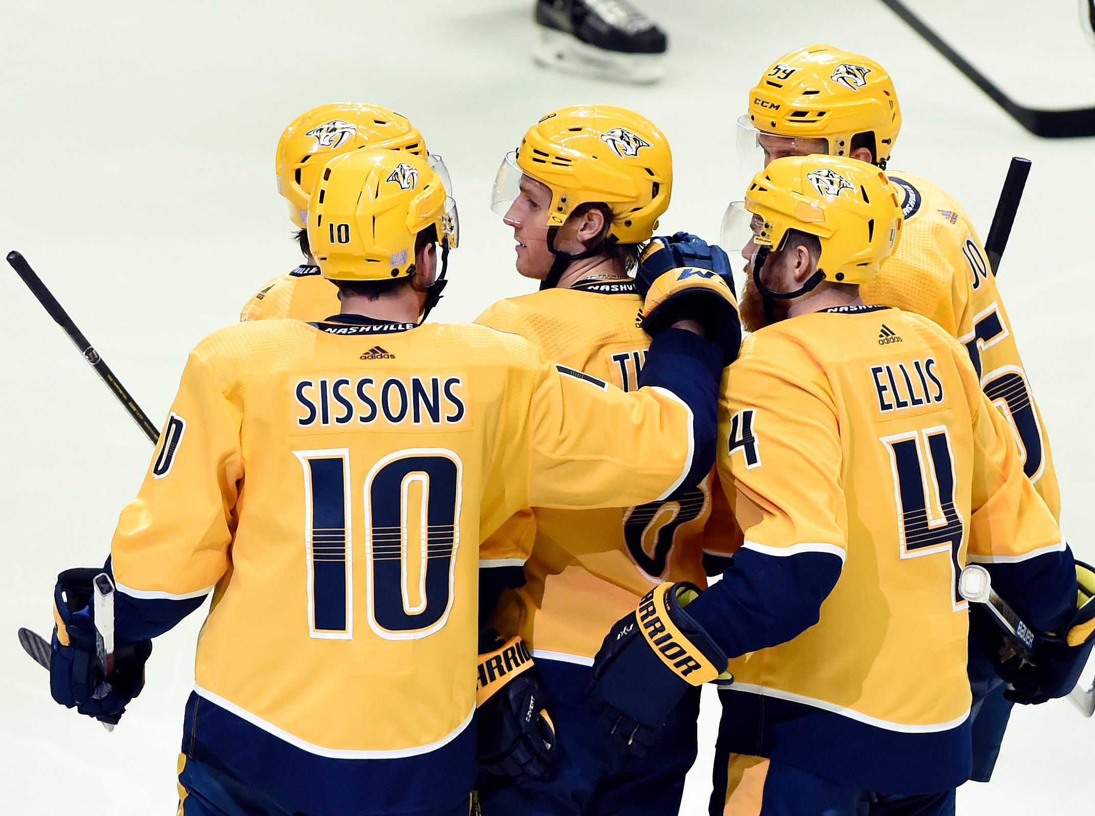 Nashville Predators center Kyle Turris, center, is congratulated after scoring a goal against the Los Angeles Kings during the second period of an NHL hockey game Saturday, Nov. 17, 2018, in Nashville, Tenn.