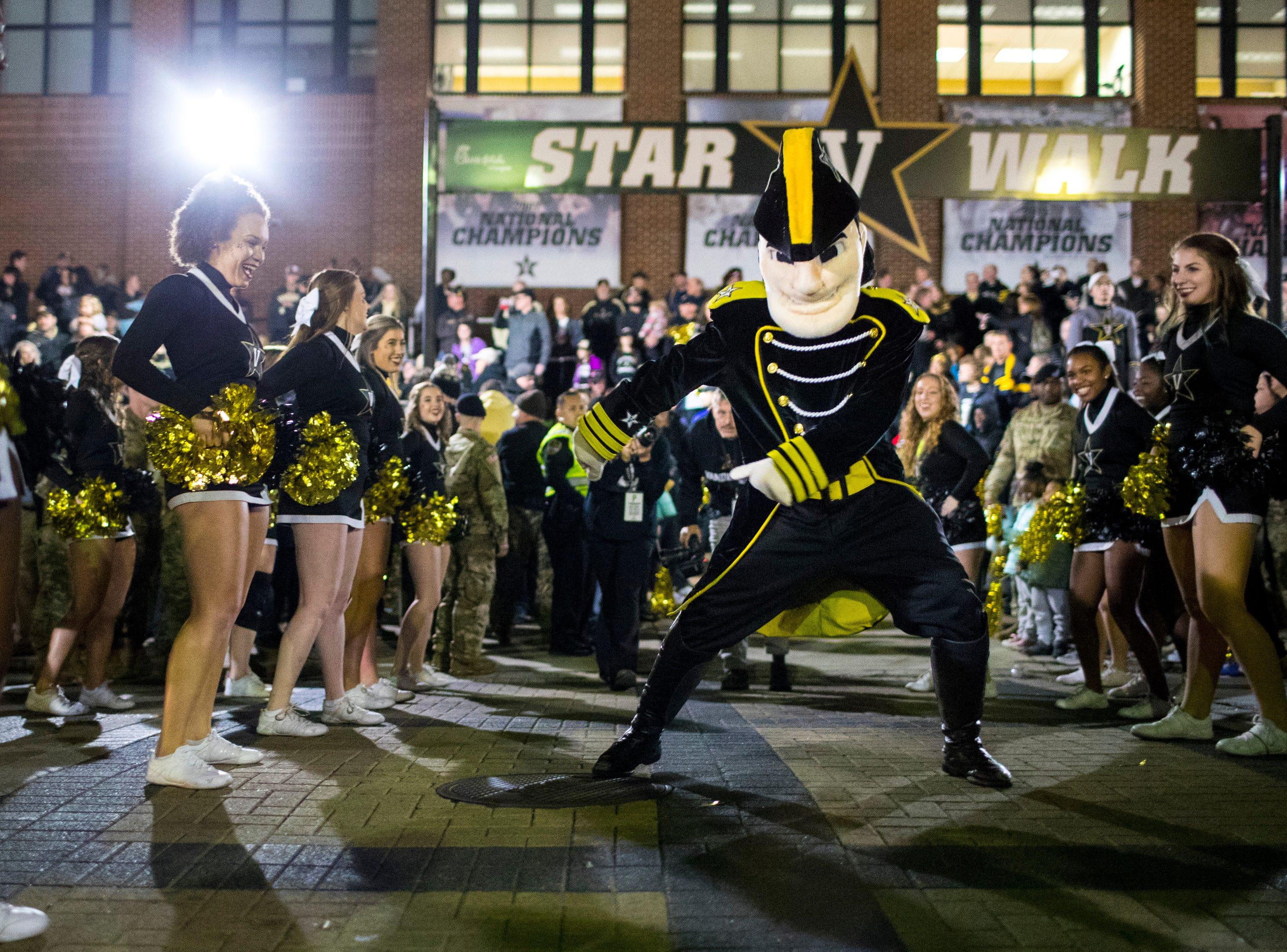 Mr. Commodore does the floss dance during the star walk before Vanderbilt's game against Ole Miss, outside of Vanderbilt Stadium in Nashville on Saturday, Nov. 17, 2018.