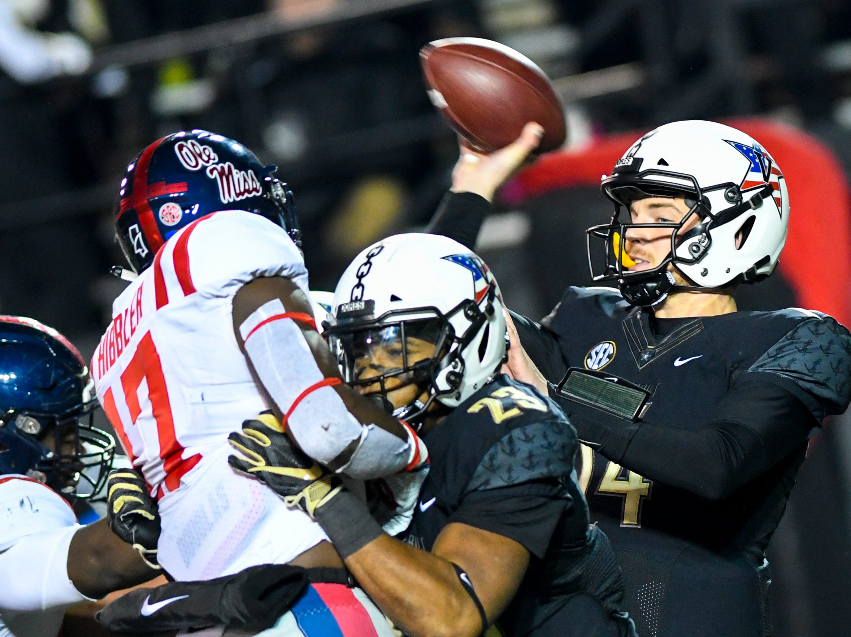 Vanderbilt quarterback Kyle Shurmur (14) passes through traffic during Vanderbilt's game against Ole Miss at Vanderbilt Stadium in Nashville on Saturday, Nov. 17, 2018.