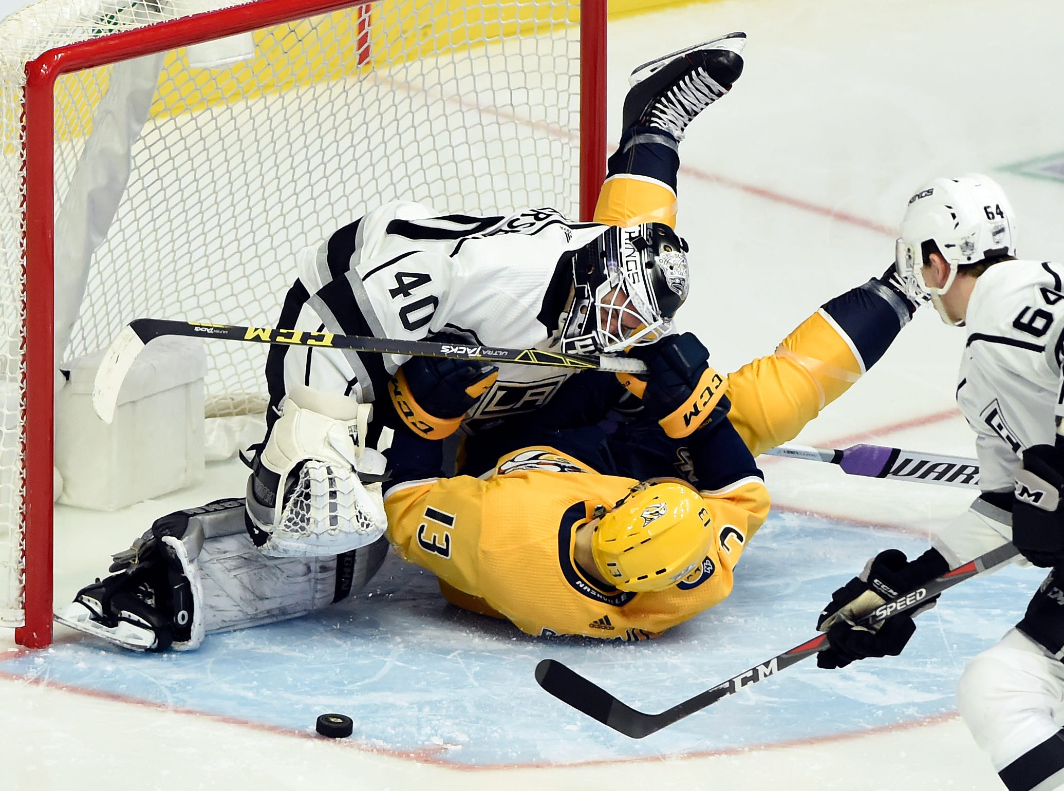Nashville Predators center Nick Bonino (13) collides with Los Angeles Kings goaltender Calvin Petersen (40) after Bonino attempted a shot during the second period of an NHL hockey game Saturday, Nov. 17, 2018, in Nashville, Tenn.
