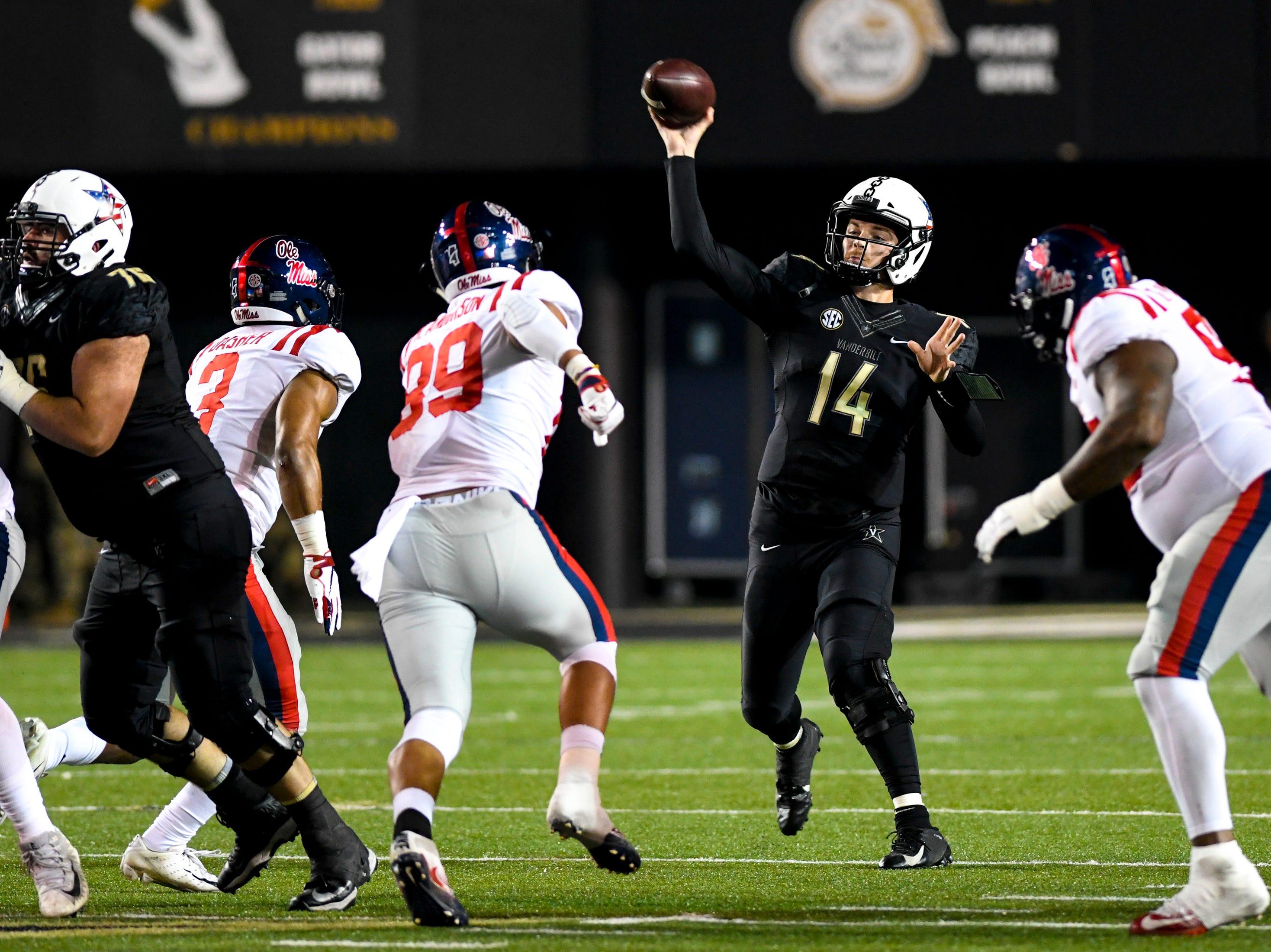 Vanderbilt quarterback Kyle Shurmur (14) passes during Vanderbilt's game against Ole Miss at Vanderbilt Stadium in Nashville on Saturday, Nov. 17, 2018.
