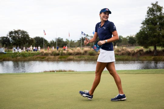 Lexi Thompson walks up to collect her trophy after winning the CME Group Tour Championship, the final event of the LPGA Tour, on Sunday at Tiburón Golf Club in Naples.