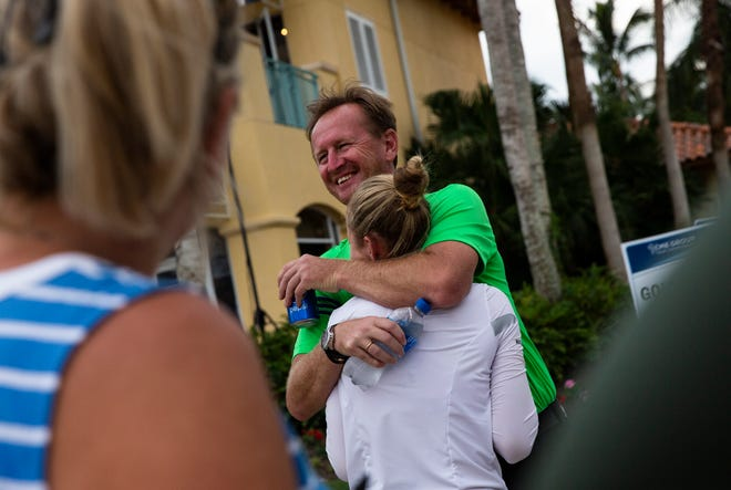 Nelly Korda is hugged and congratulated on her performance by her father and former tennis star, Petr Korda, after the season-ending CME Group Tour Championship at Tiburón Golf Club in Naples on Sunday.