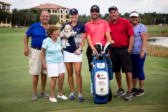 Lexi Thompson poses for a photo with her family after winning the CME Group Tour Championship, the final event of the LPGA Tour, on Sunday at Tiburón Golf Club in Naples.