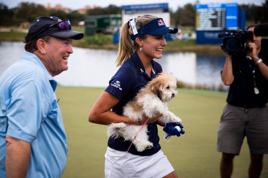 Lexi Thompson carries her dog Leo after winning the CME Group Tour Championship, the final event of the LPGA Tour, on Sunday, Nov. 18, 2018 at Tiburón Golf Club in Naples.