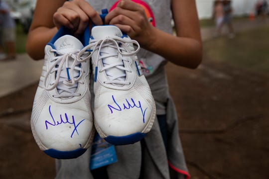 Nelly Korda of Bradenton gave away her Adidas sport shoes to young fan, Averi Negron after the season-ending CME Group Tour Championship at Tiburón Golf Club in Naples on Sunday. It was Averi's birthday on the final day of the event and she was able to get a pair of shoes from Nelly and a single shoe from Lexi Thompson.