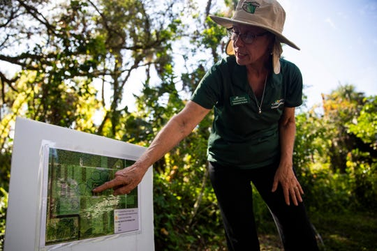 Alexandra Sulecki, then-coordinator of the Conservation Collier Program, points out existing and planned trails to visitors during the soft opening of the Naithloriendun Sanctuary, also known as the Gore sanctuary, on Sunday, Nov. 18, 2018, in Golden Gate Estates.