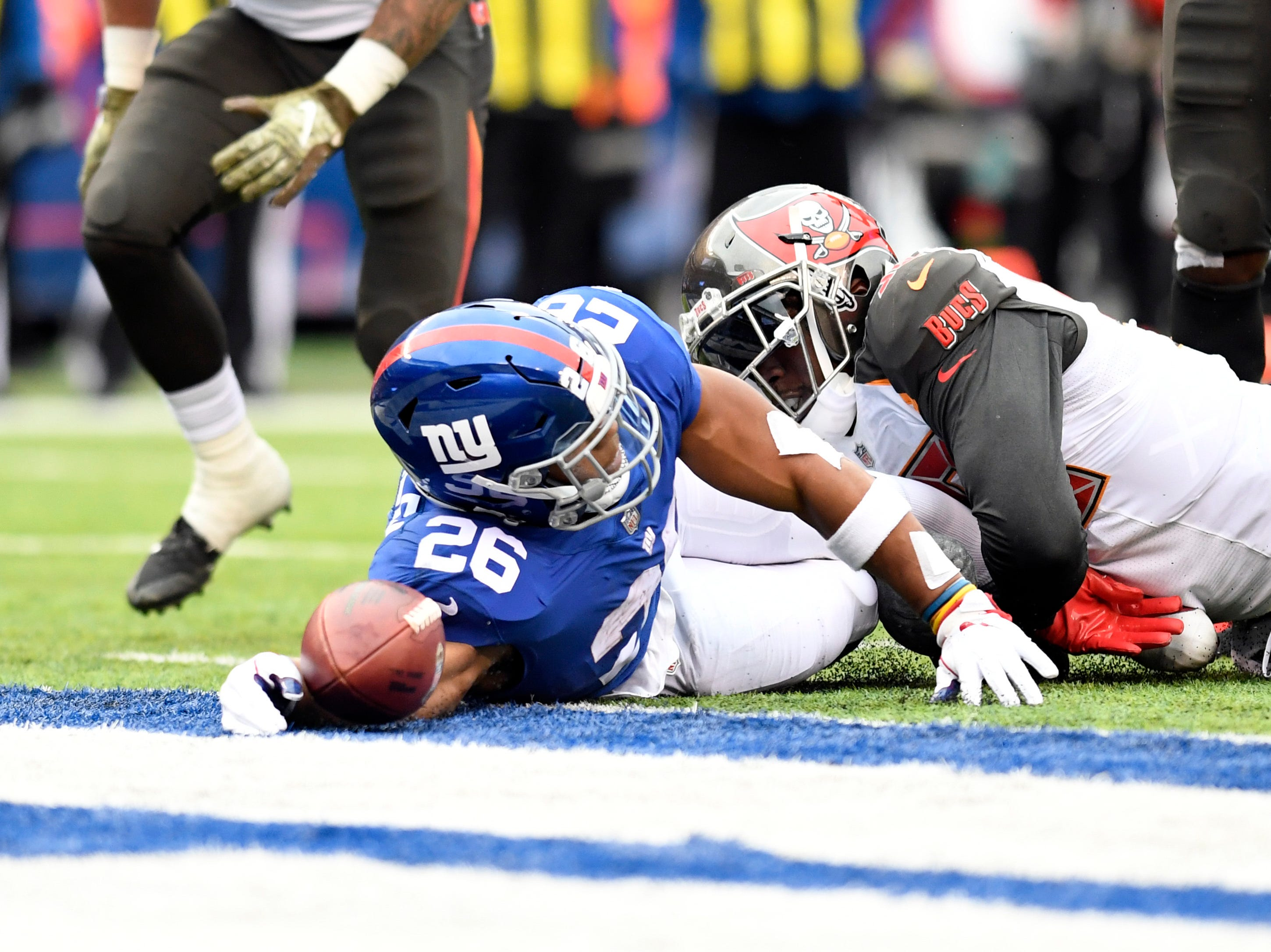 New York Giants running back Saquon Barkley (26) dives into the endzone for a touchdown against the Tampa Bay Buccaneers in the first half on Sunday, Nov. 18, 2018 in East Rutherford.