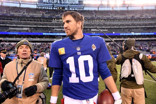 New York Giants quarterback Eli Manning (10) holds a game ball as he leaves the field after defeating the Tampa Bay Buccaneers 38-35 on Sunday, Nov. 18, 2018 in East Rutherford.