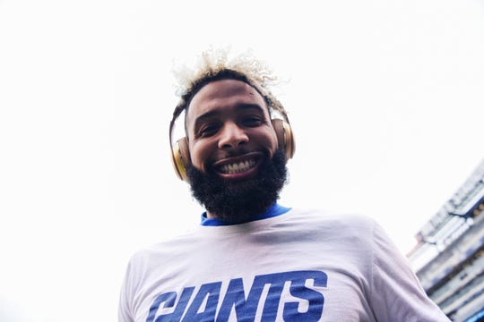 New York Giants wide receiver Odell Beckham Jr. smiles for the camera during warmups. The New York Giants face the Tampa Bay Buccaneers in NFL Week 11 on Sunday, Nov. 18, 2018 in East Rutherford.
