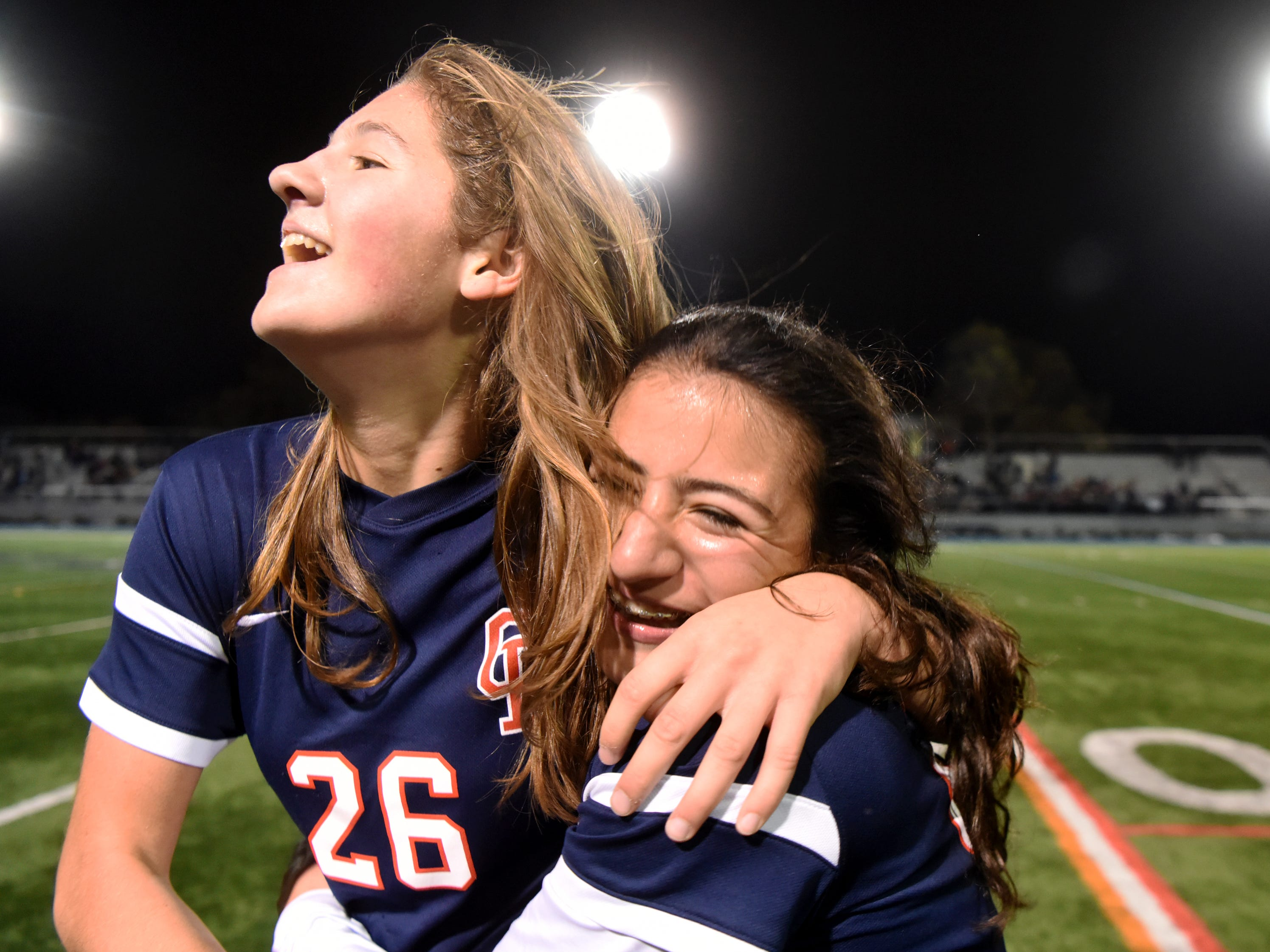 Governor Livingston's Allie Post (26) and Catalina Abusada celebrate Abusada's game-winning goal against Ramsey in the Group II final on Sunday, Nov. 18, 2018 at Kean University.