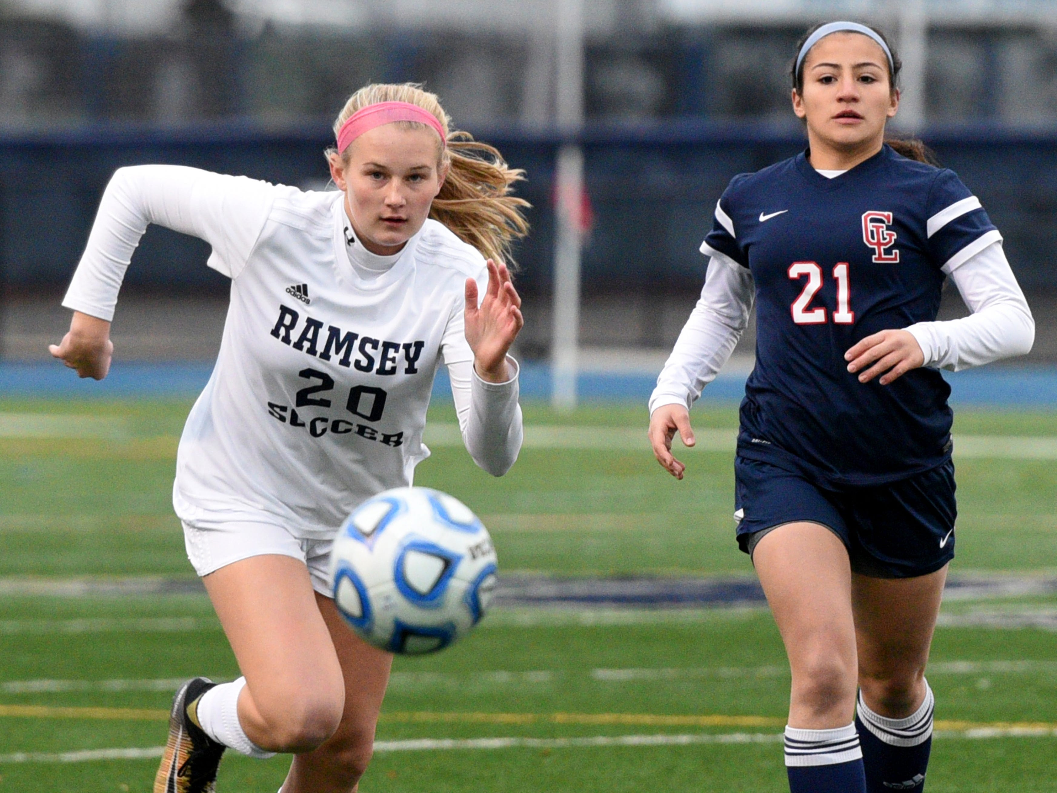 Ramsey's Caroline Schwanewede (20) and Governor Livingston's Catalina Abusada go for the ball during the Group II final on Sunday, Nov. 18, 2018 at Kean University.