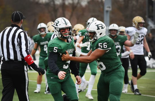 Ramapo QB AJ Wingfield (no. 5) is congratulated by his teammate Fernon Patterson (no. 56) after his touchdown against River Dell in the second half during the North 1, Group 3 football final at Ramapo High School in Franklin Lakes on 11/18/18.