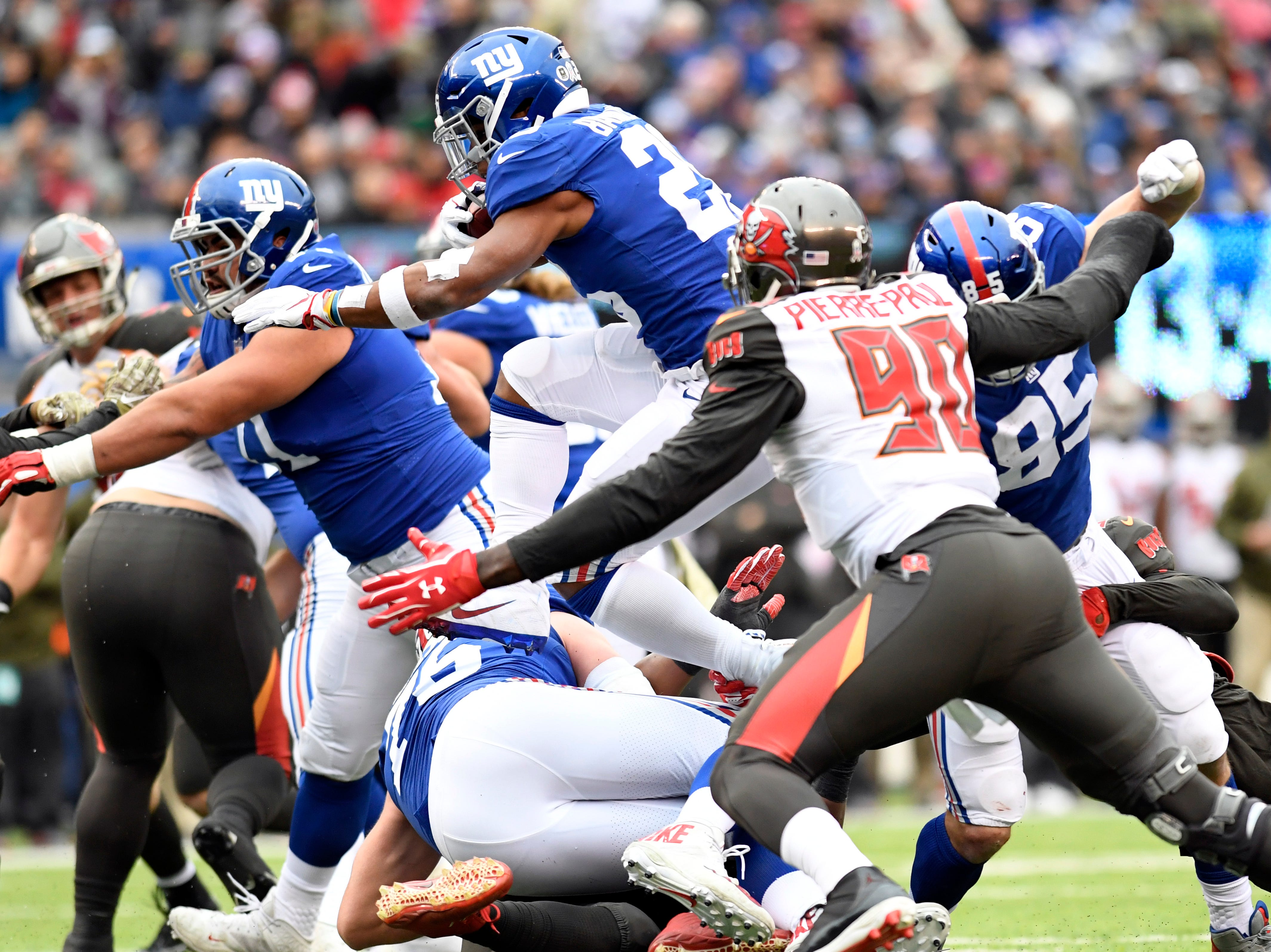 New York Giants running back Saquon Barkley (26) leaps over his own teammate on his way to touchdown in the first half against the Tampa Bay Buccaneers on Sunday, Nov. 18, 2018 in East Rutherford.