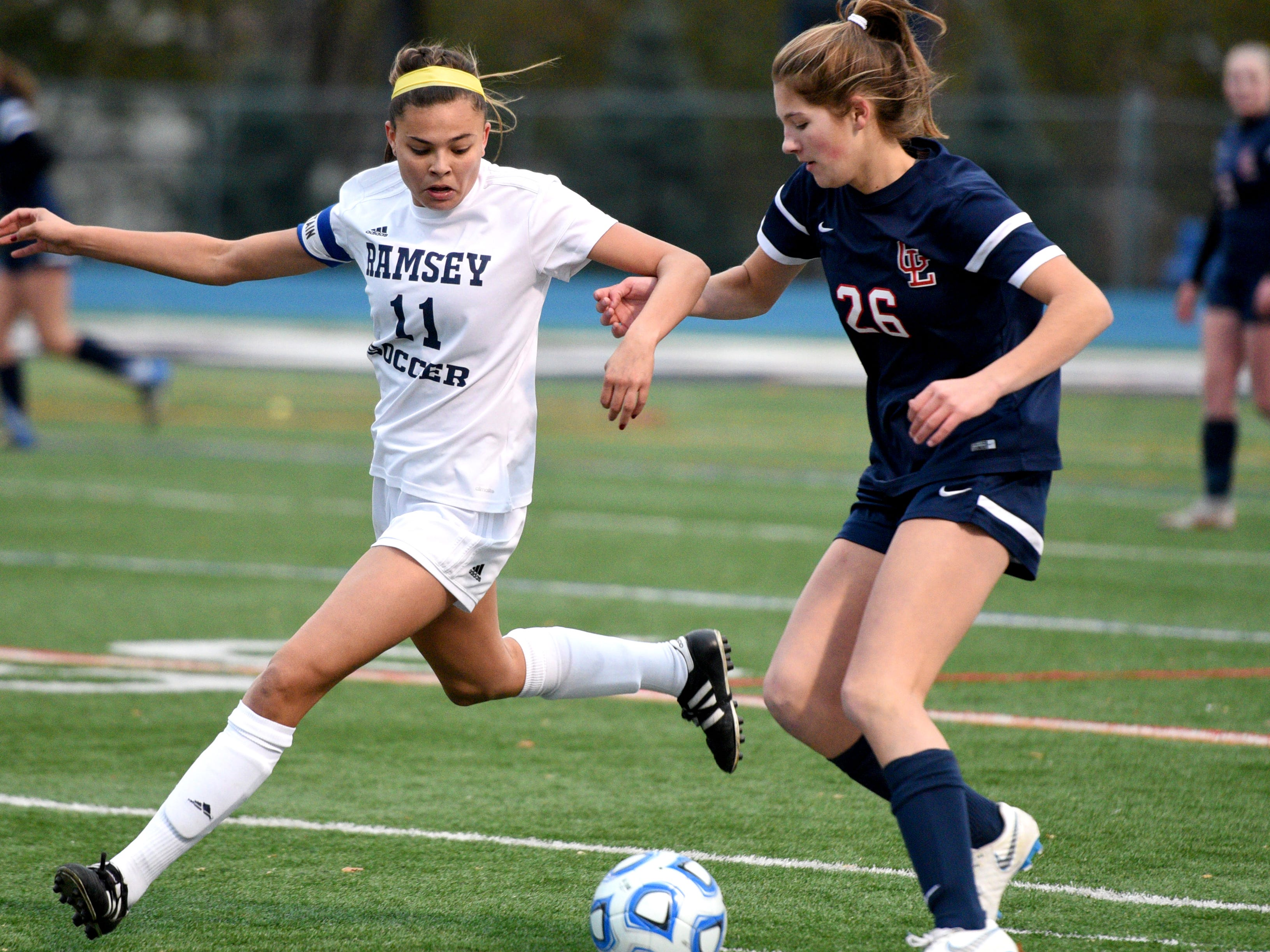 Ramsey's Alex Correa (11) and Governor Livingston's Allie Post  during the Group II final on Sunday, Nov. 18, 2018 at Kean University.