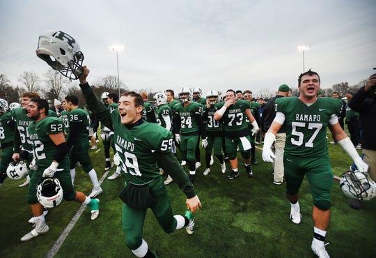Ramapo players celebrate their championship victory 31 to 7 over River Dell in the second half during the North 1, Group 3 football final at Ramapo High School in Franklin Lakes on 11/18/18.