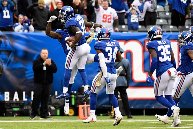 New York Giants safety Michael Thomas (31) celebrates an interception against the Tampa Bay Buccaneers in the first half on Sunday, Nov. 18, 2018 in East Rutherford.