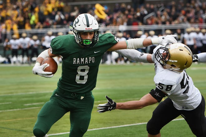 Luke Ragone (8) of Ramapo tries to avoid being tackled by Aaron Furneaux (58) of River Dell in the first half during the North 1, Group 3 football final at Ramapo High School in Franklin Lakes on Nov. 18, 2018.