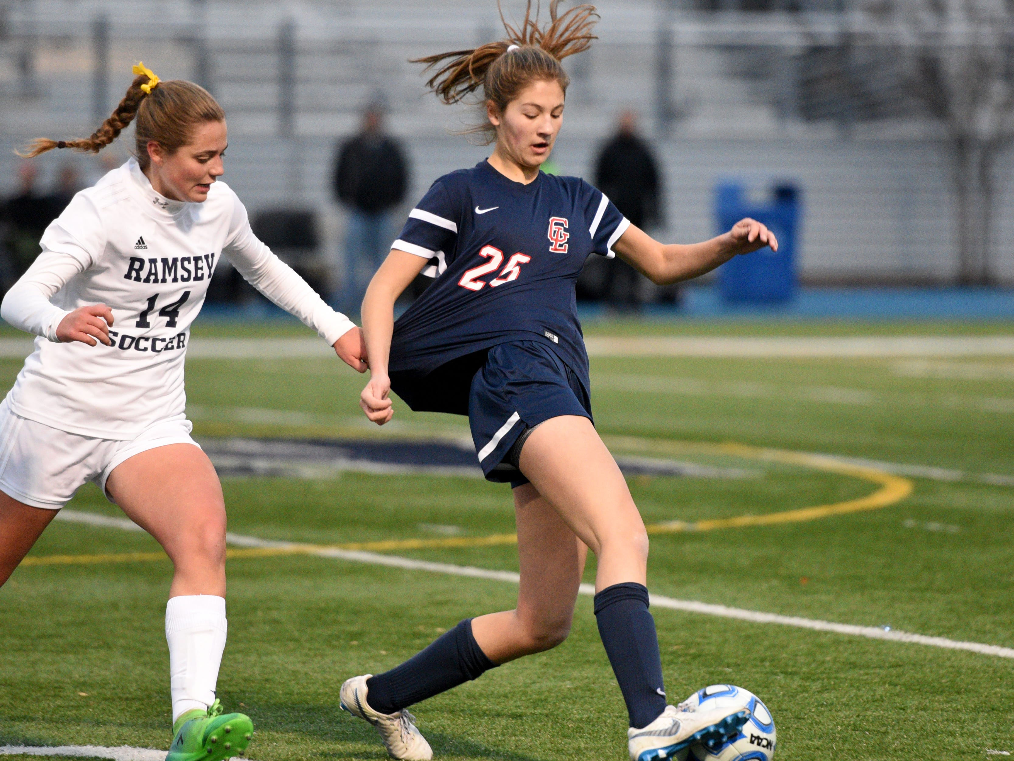 Ramsey's Melanie Mack (14) and Governor Livingston's Lauren Paprocki battle for the ball during the Group II final on Sunday, Nov. 18, 2018 at Kean University.