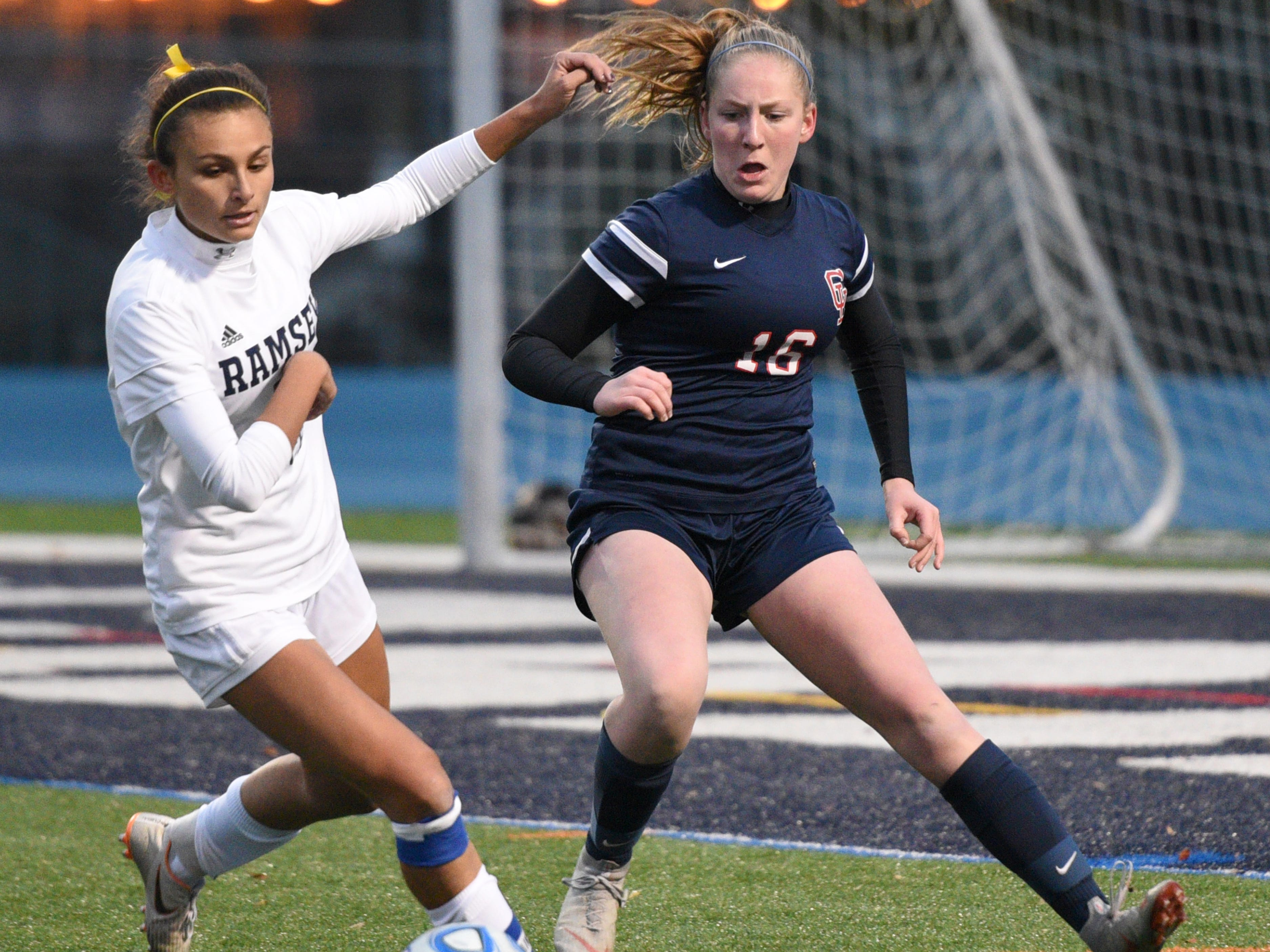 Ramsey's Marisa McEntee (left) and Governor Livingston's Kelsey DiStaso battle for the ball during the Group II final on Sunday, Nov. 18, 2018 at Kean University.