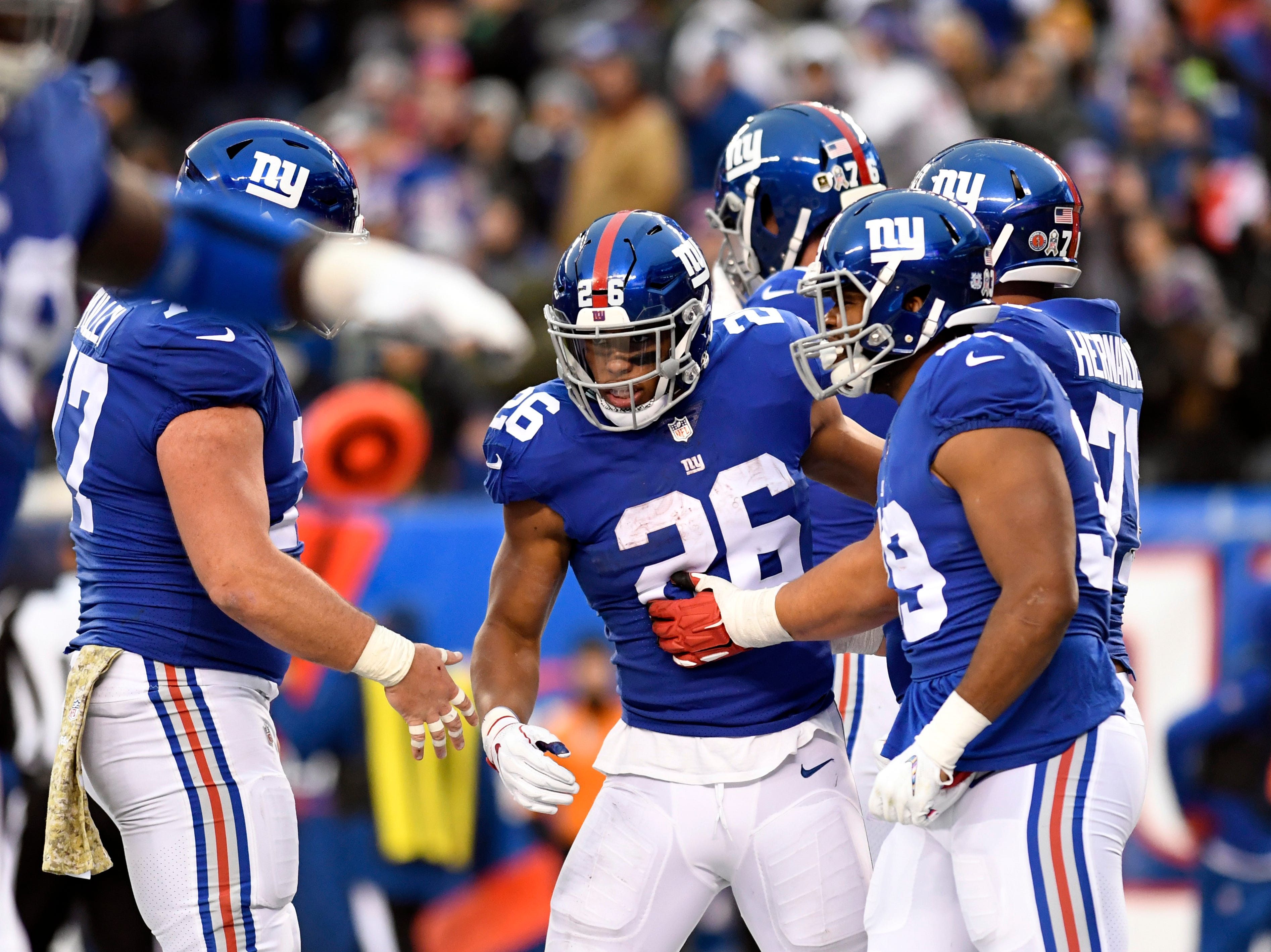 New York Giants running back Saquon Barkley (26) celebrates his touchdown in the second half. The New York Giants defeat the Tampa Bay Buccaneers 38-35 on Sunday, Nov. 18, 2018 in East Rutherford.