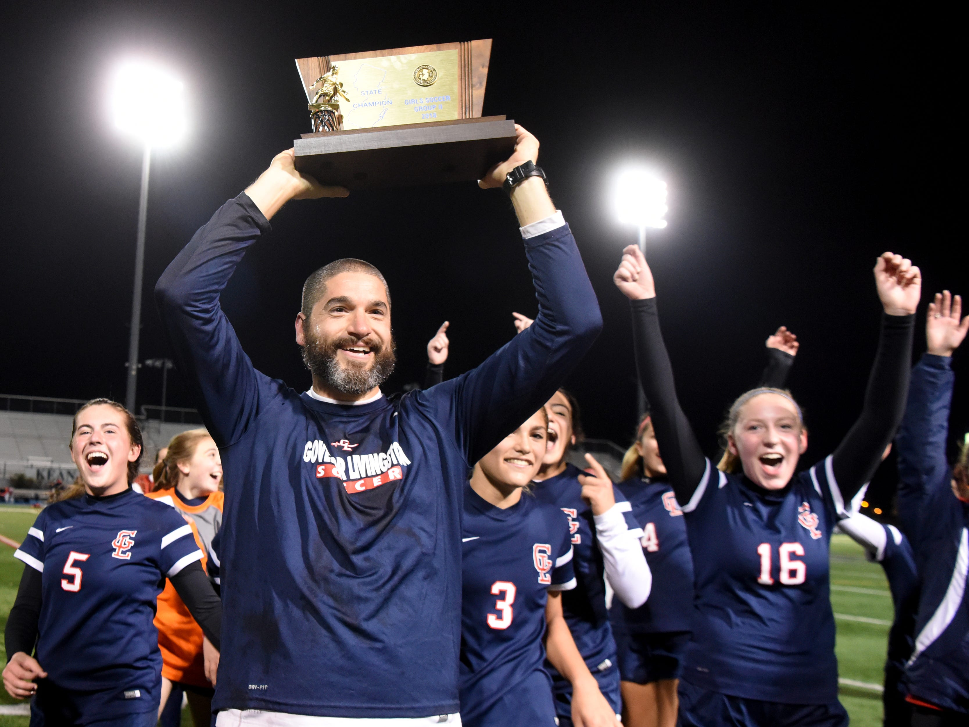 Governor Livingston head coach Mike Roof celebrates with his players after their Group II victory over Ramsey on Sunday, Nov. 18, 2018 at Kean University.