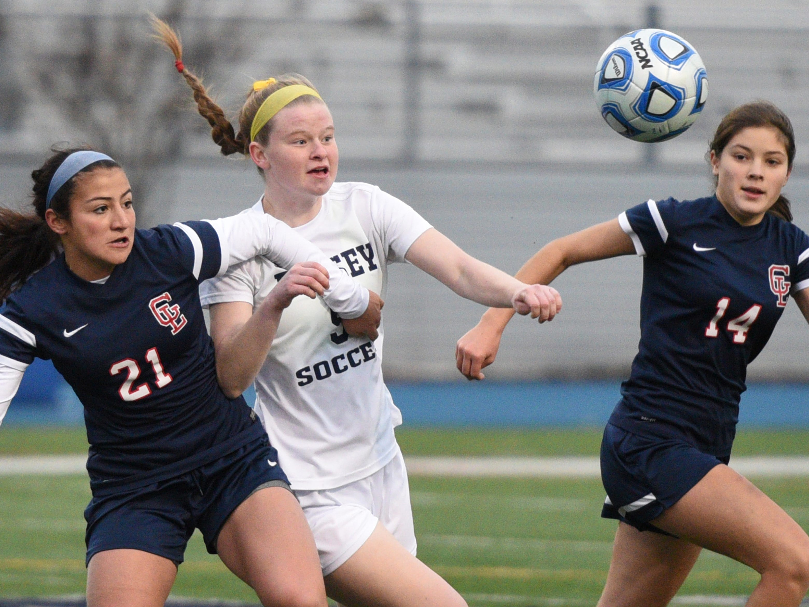 Governor Livingston's Catalina Abusada (21) and Ramsey's Olivia Molinari (middle) fight for possession of a loose ball during the Group II final on Sunday, Nov. 18, 2018 at Kean University.