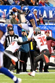 New York Giants tight end Evan Engram (88) jumps over a Tampa Bay Buccaneer defender in the second half. The New York Giants defeat the Tampa Bay Buccaneers 38-35 on Sunday, Nov. 18, 2018 in East Rutherford.