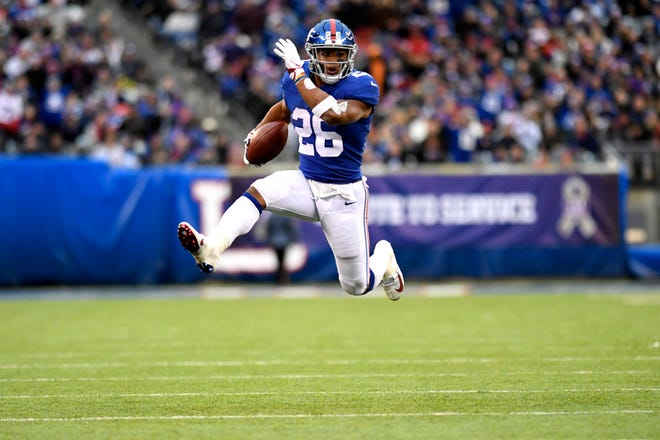 New York Giants running back Saquon Barkley (26) rushes against the Tampa Bay Buccaneers in the second half. The Giants defeat the Buccaneers 38-35 on Sunday, Nov. 18, 2018 in East Rutherford.