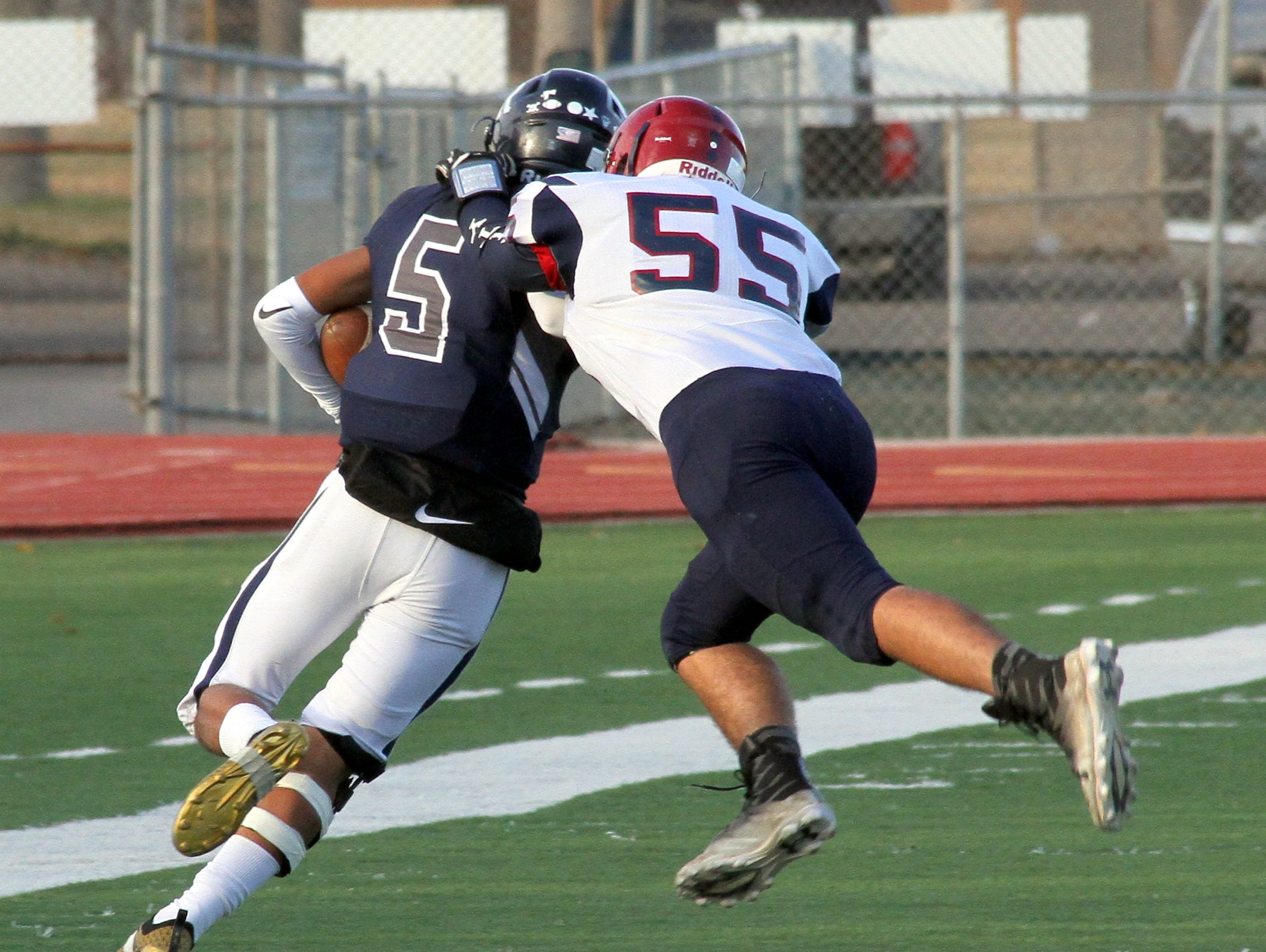 'Cat Justin Morgan (55) chases down Marcos Hernandez.