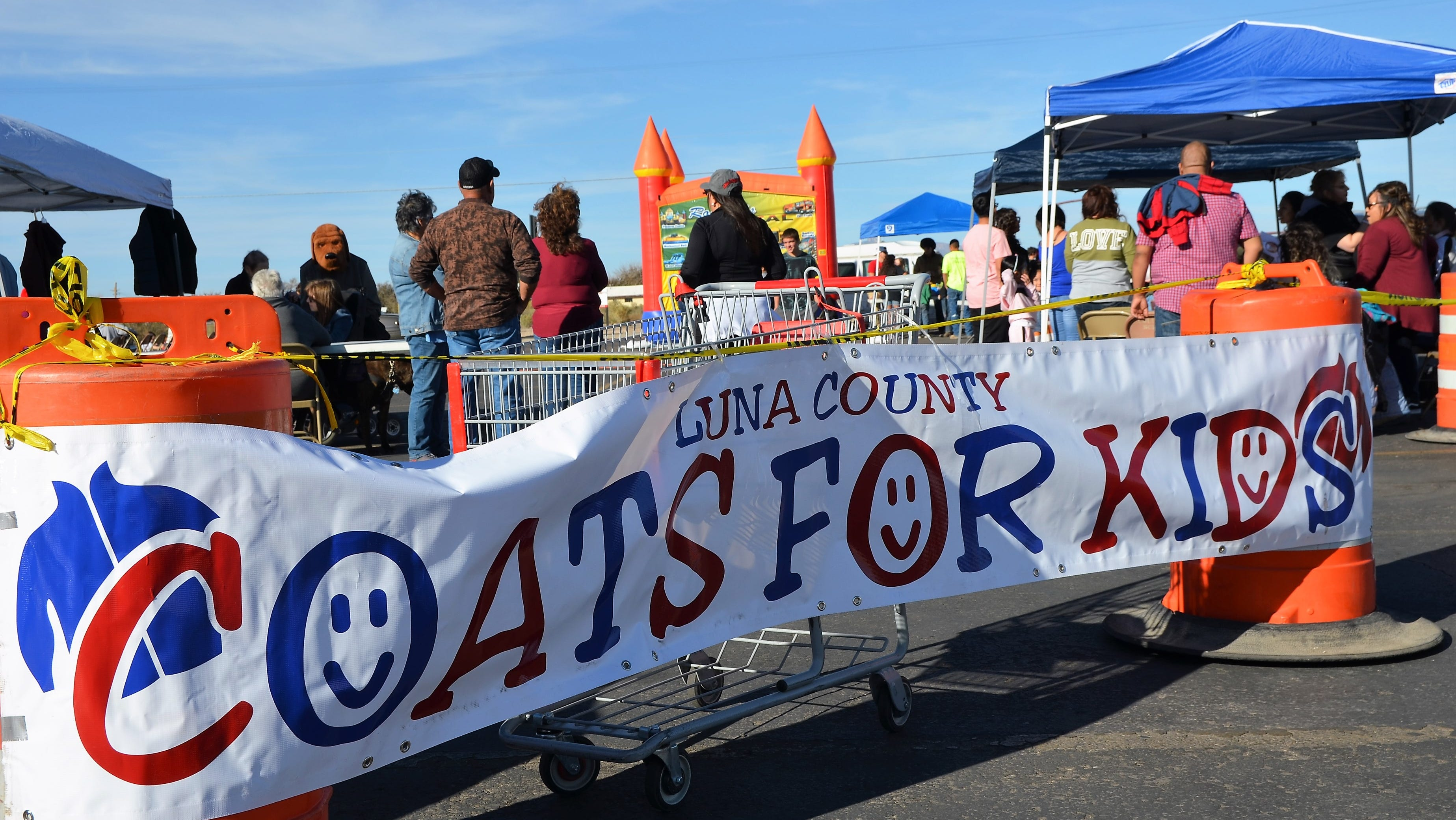 Luna County Coats for Kids banner separates event from Peppers Supermarket parking lot.