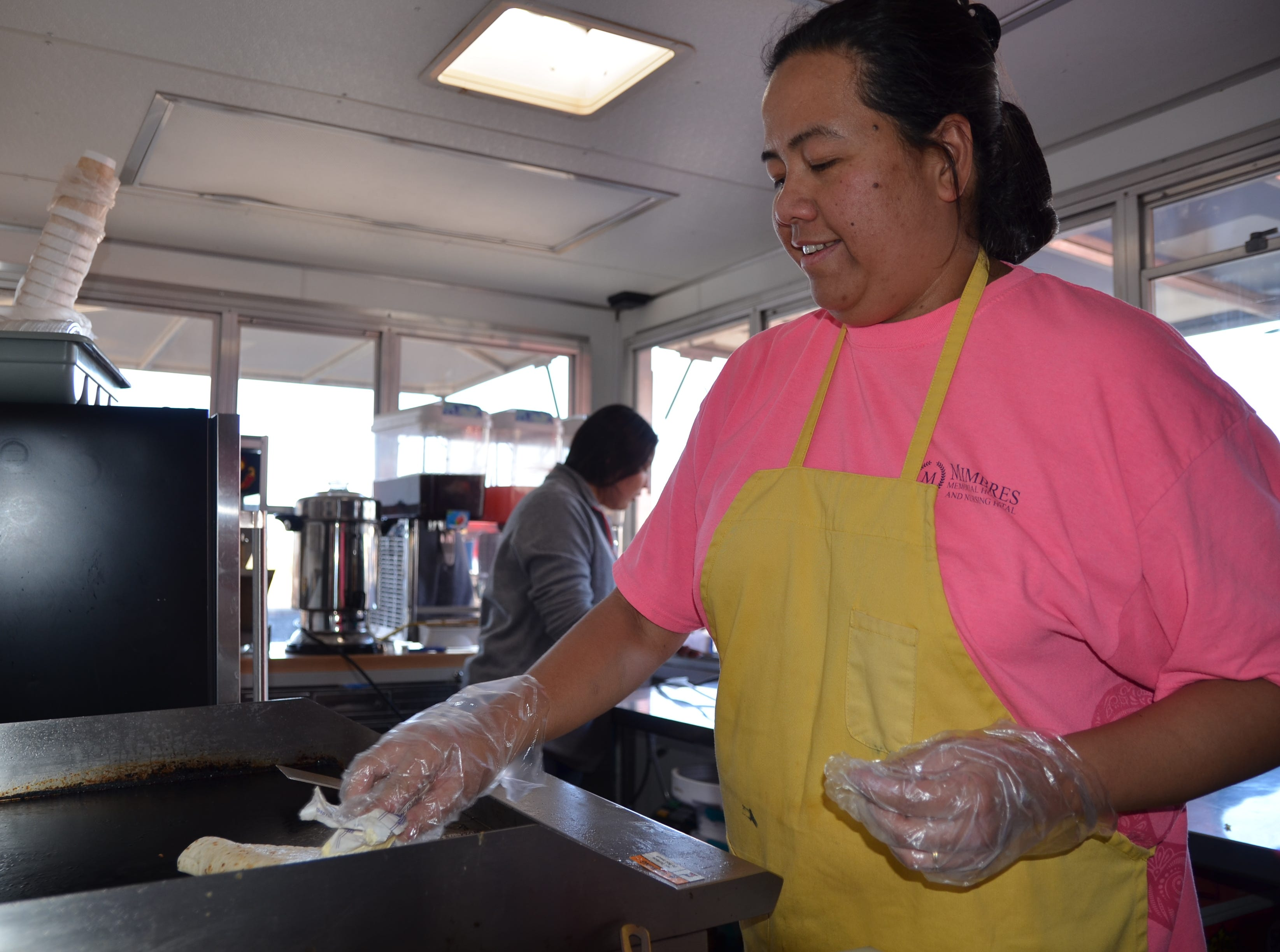 Racquel Mendoza of End of the Trail food truck preps a quesadilla on the comal for a customer to enjoy.