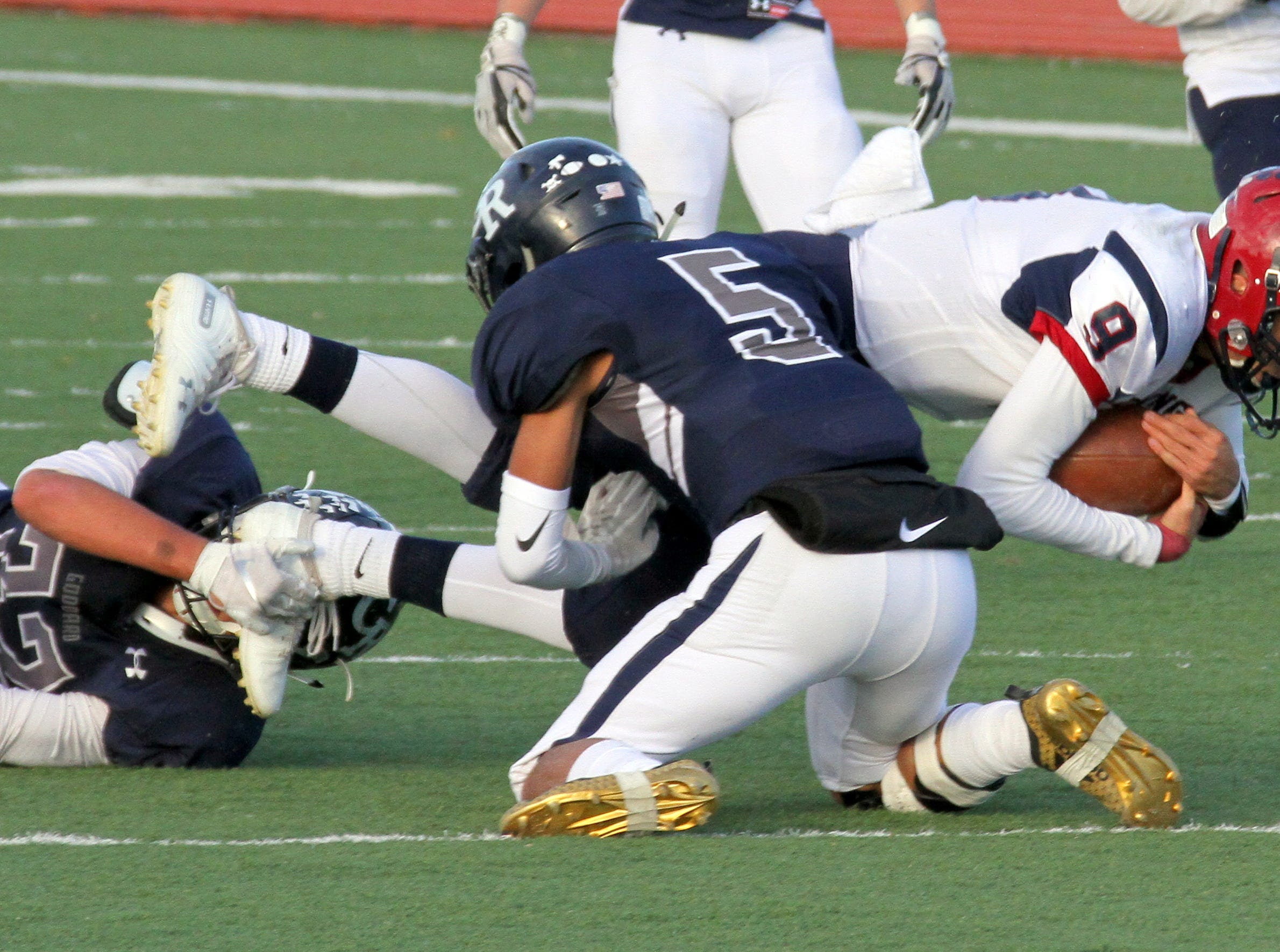 'Cat quarterback Daniel Garcia (9) stretches for a first down.