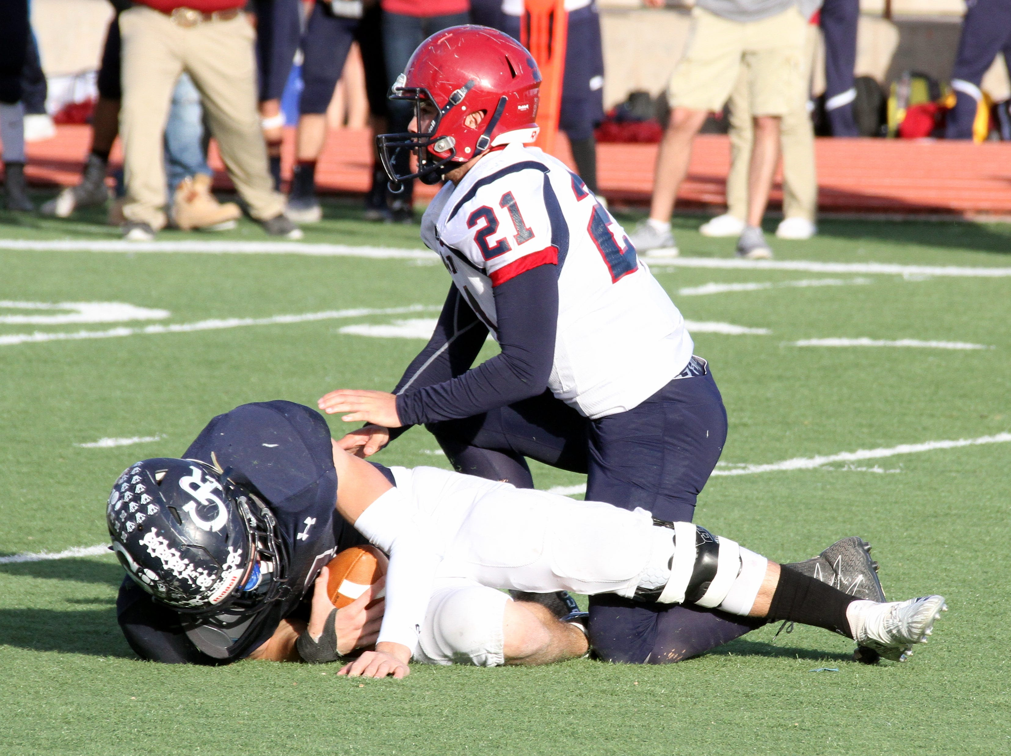 'Cat Gabriel Reza (21) came in on a blitz and sacked Goddard quarterback Dalton Bowles.
