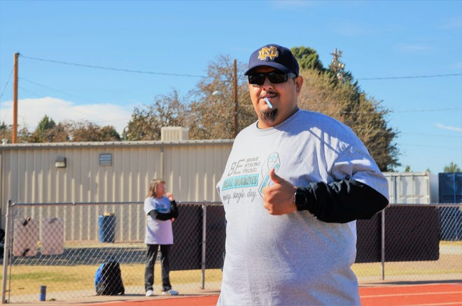 Dustin Armendariz gives a thumbs up to the camera while participating in the Luna County Fighting Diabetes 2-mile walk.