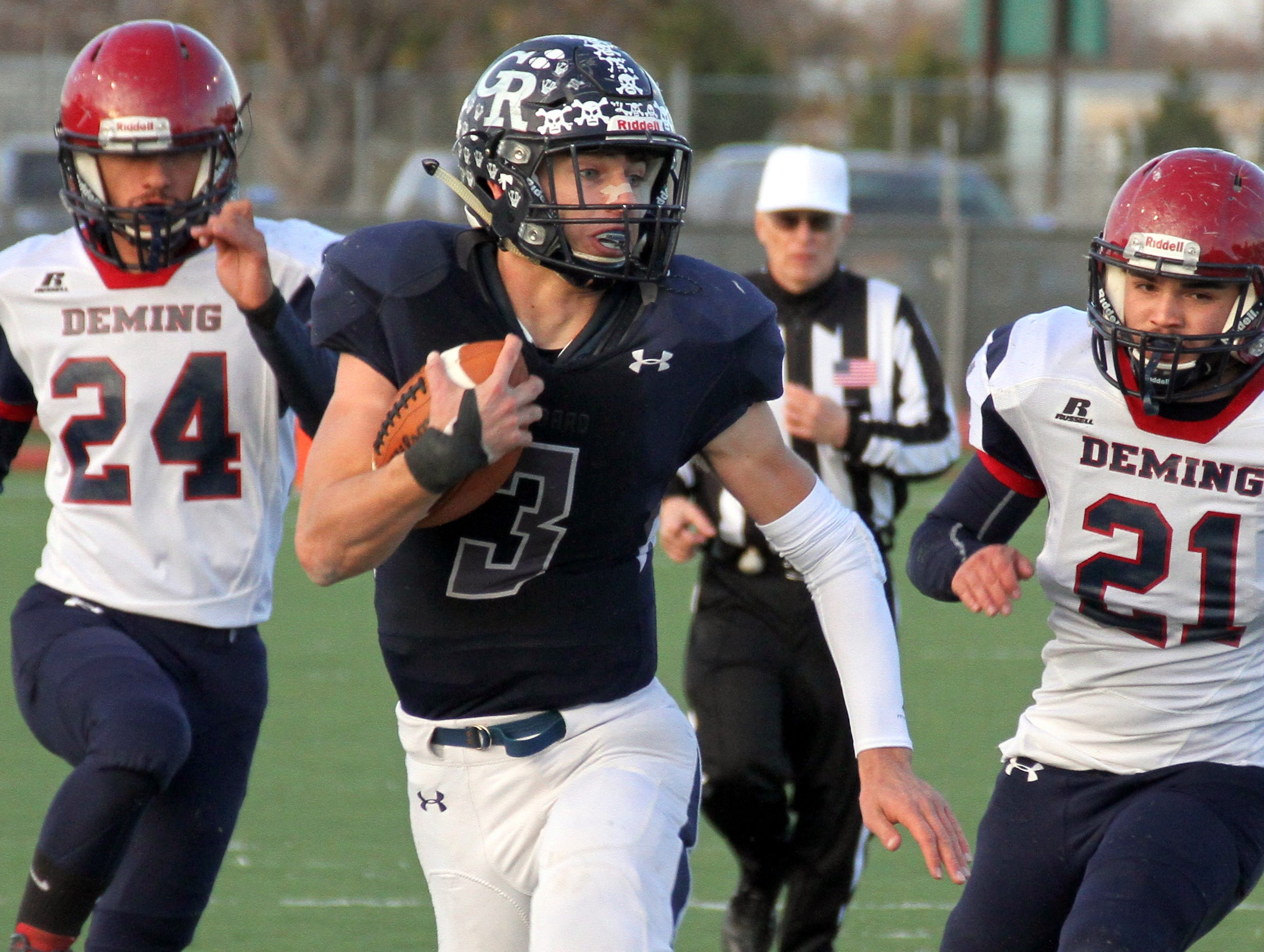 Wildcats James Carroll (24) and Gabriel Reza (21) in pursuit of Rockets quarterback Dalton Bowles.