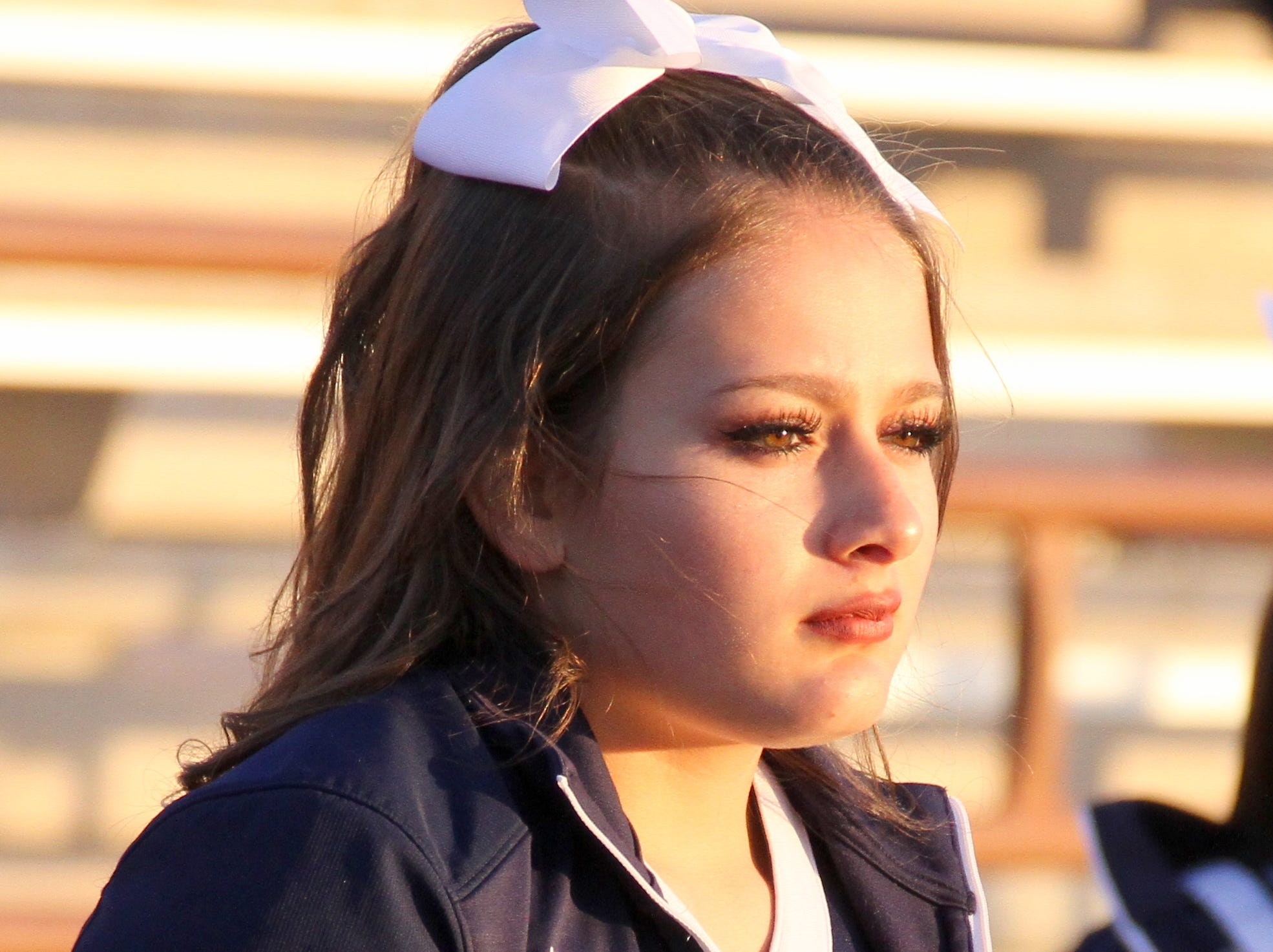 Wildcat cheerleader Ciera Wood is focused on the playoff action between the Goddard High Rockets and the Deming High Wildcats.