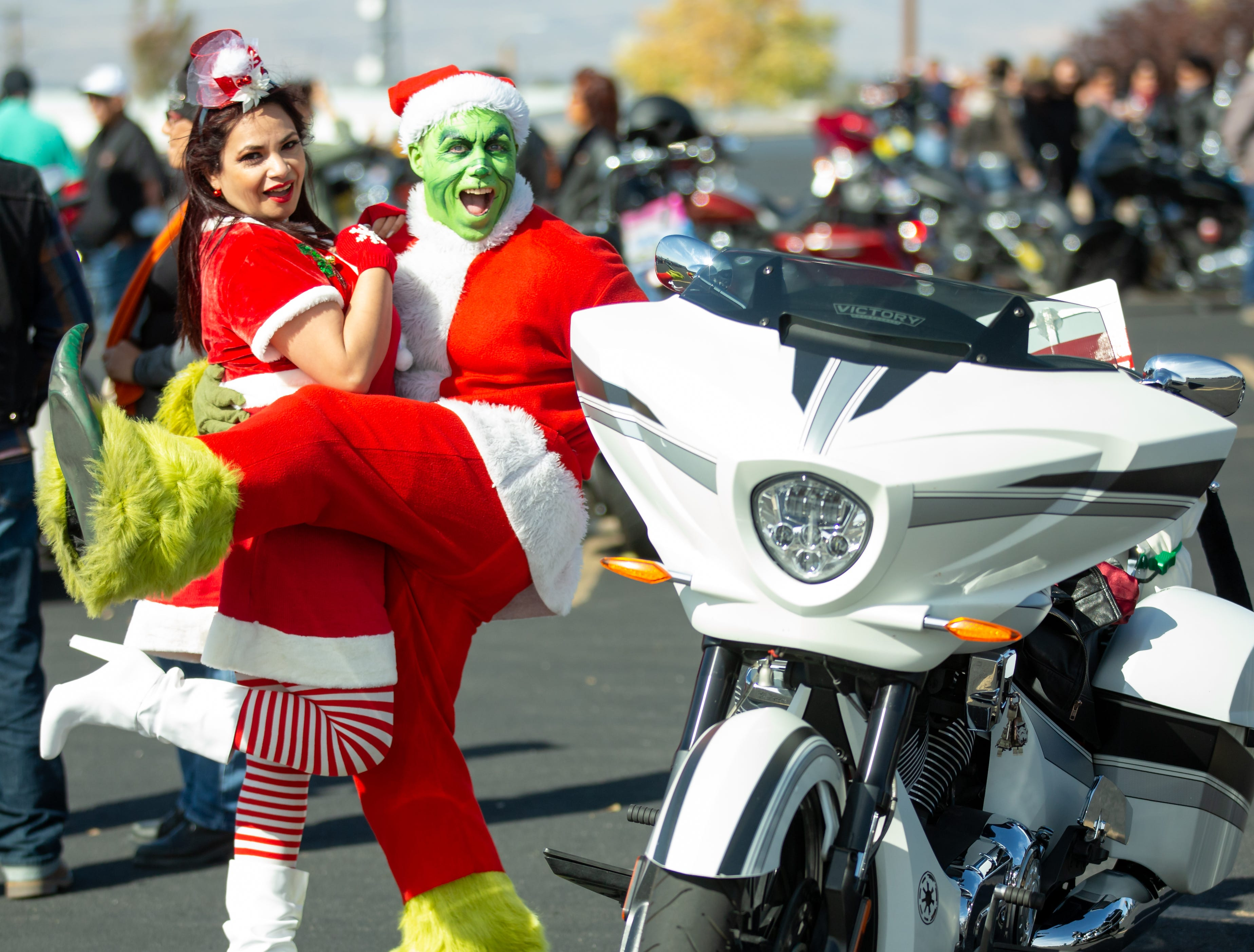 The Grinch and Martha May make an appearance on Sunday Nov. 18, 2018, during the 38th annual Toys for Kids Motorcycle Parade to benefit children in southern New Mexico. The Grinch was giving out boxes of coal wrapped pink boxes.