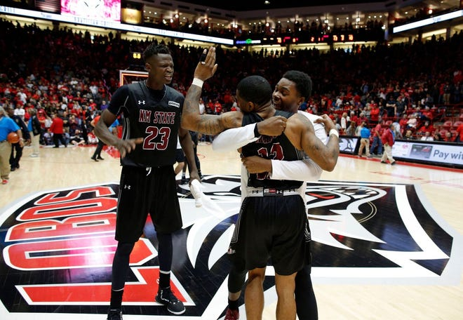 New Mexico State players celebrating after beating New Mexico on Saturday at The Pit.