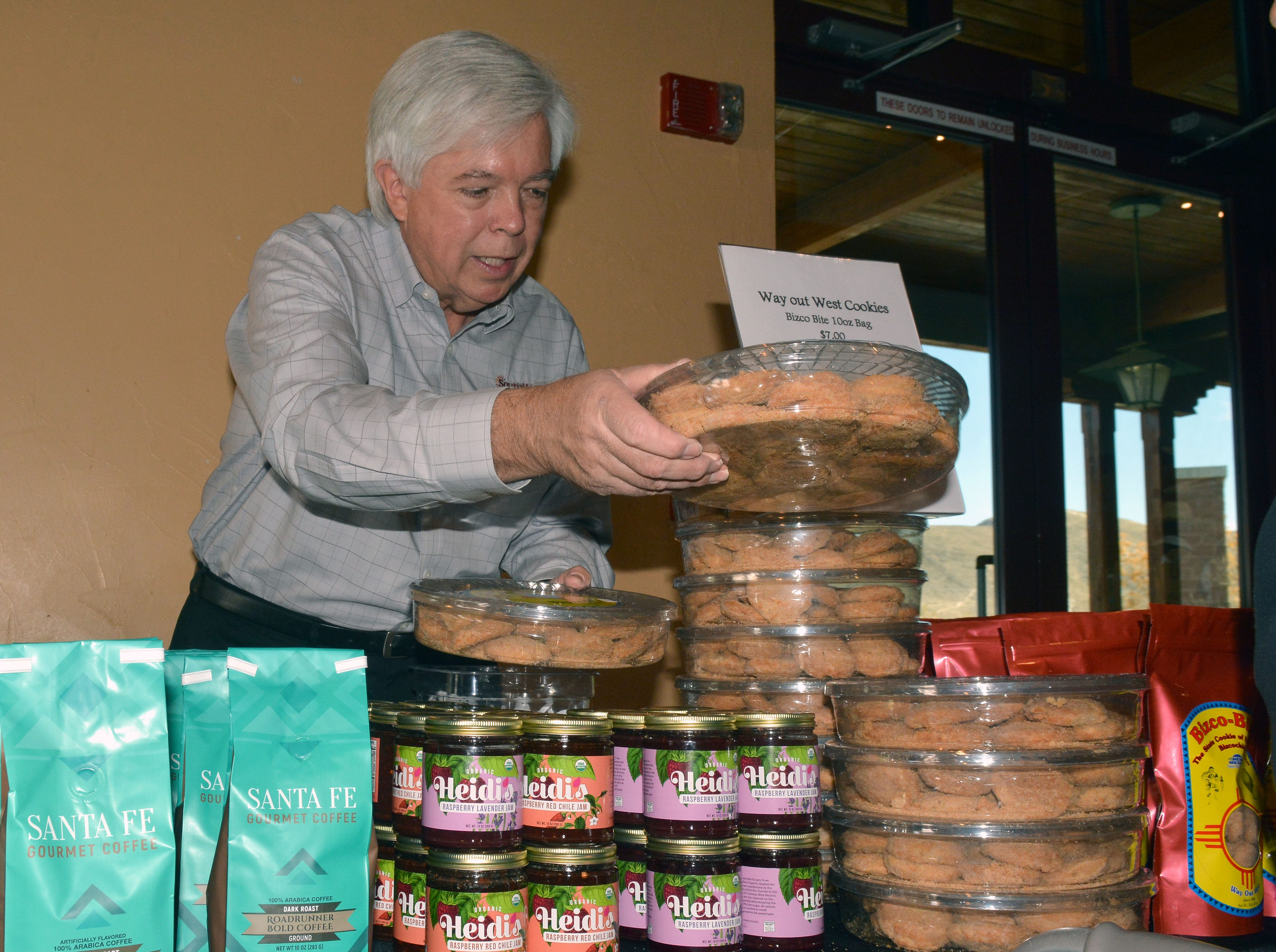 Patrick Beare of Southwest Best Brands displays New Mexico products his company distributes including coffee, jams and biscochitos.  Photo taken 11/17/18.