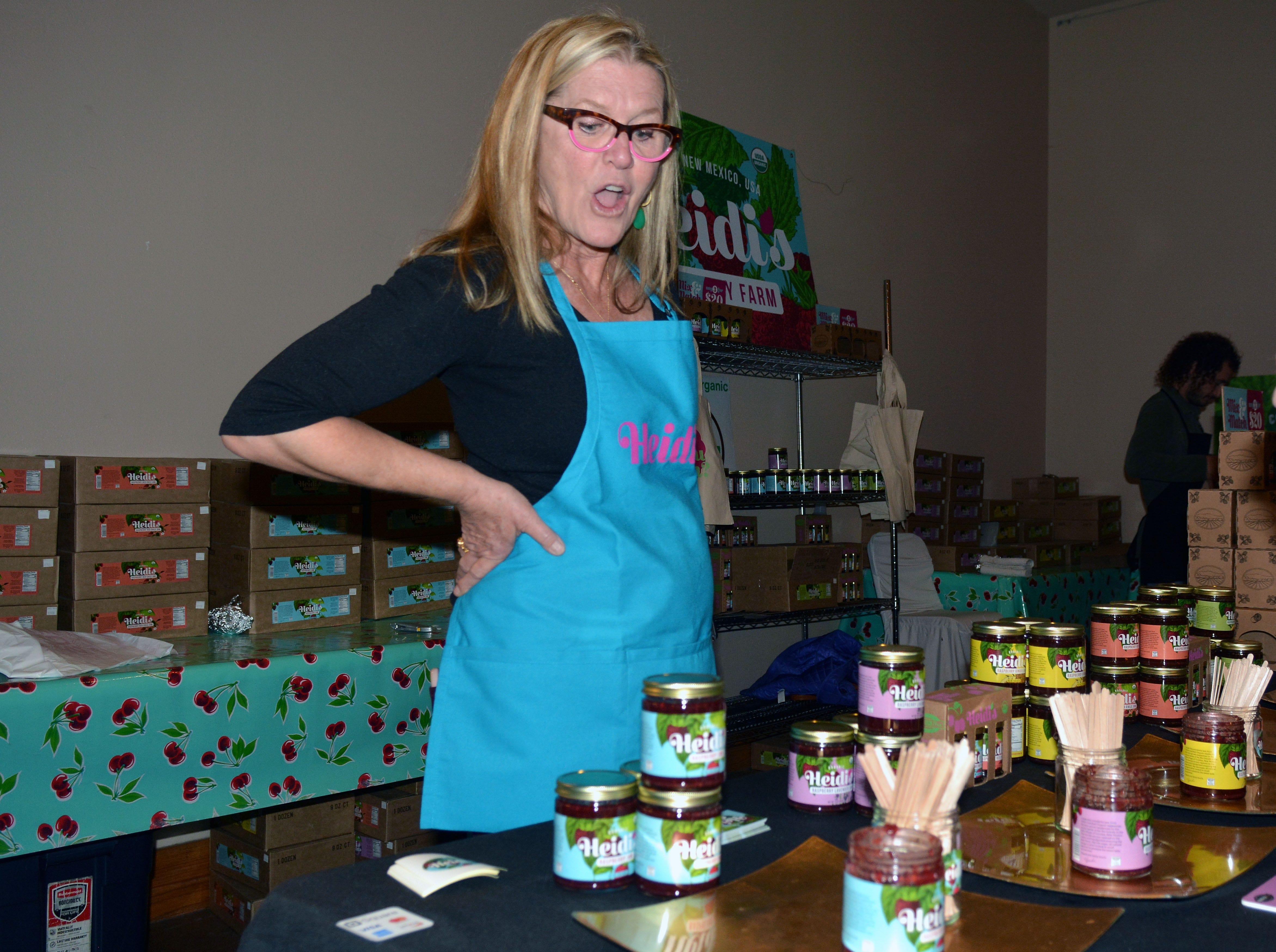 Heidi Eleftheriou of Heidi's Raspberry Farm from Corrales, NM displays her assortment of raspberry-based jams.  Photo taken 11/17/18.