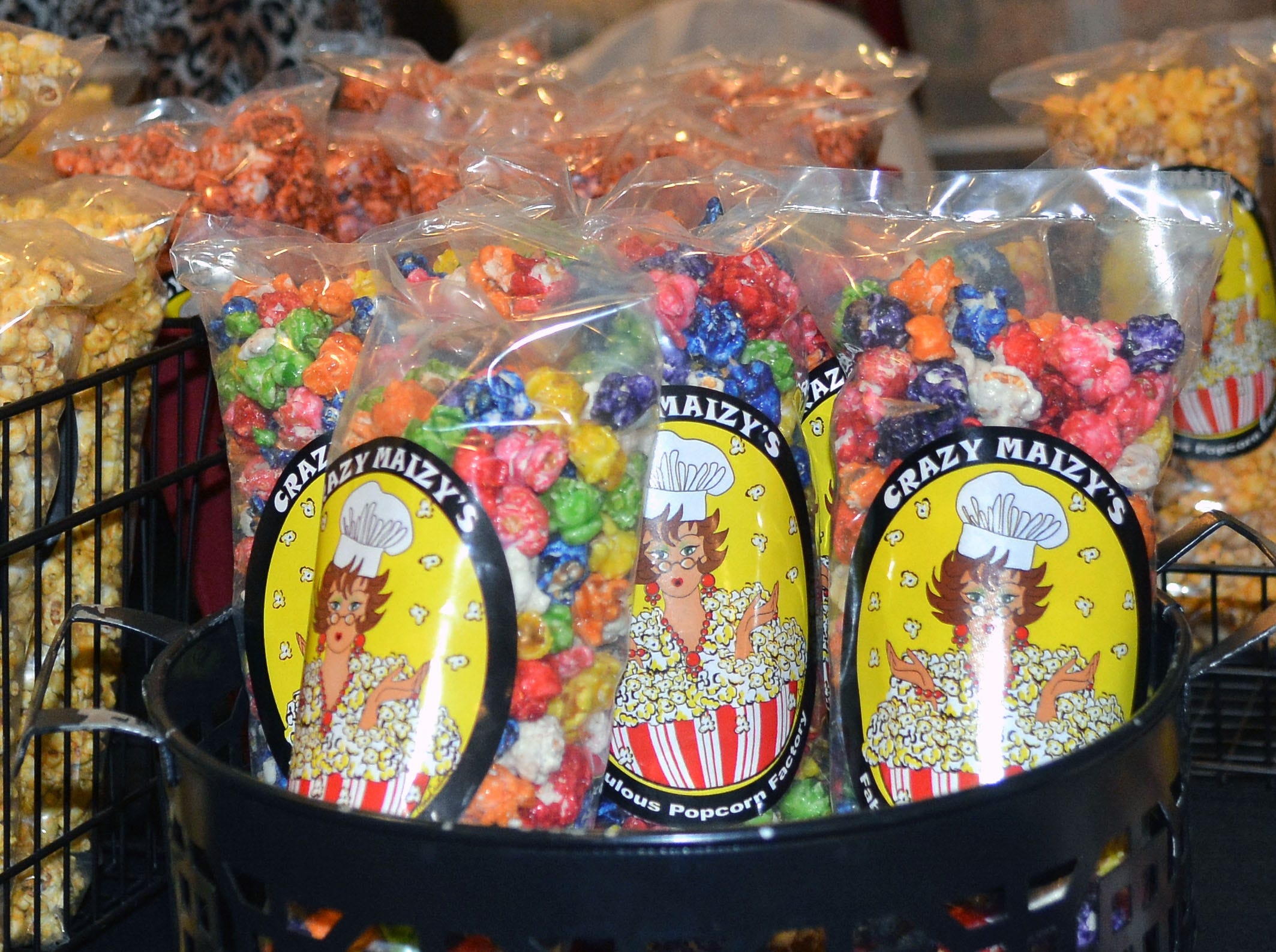 Crazy Maizy's Delicious Popcorn Factory was selling a large variety of flavored popcorns.  Photo taken 11/17/18.
