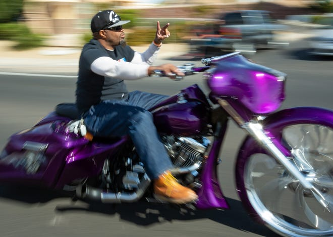 Bikers pass by on S. Don Roser Dr. on Sunday Nov. 18, 2018, during the 38th annual Toys for Kids Motorcycle Parade to benefit children in southern New Mexico. Hundreds of motorcyclist participated in the event.