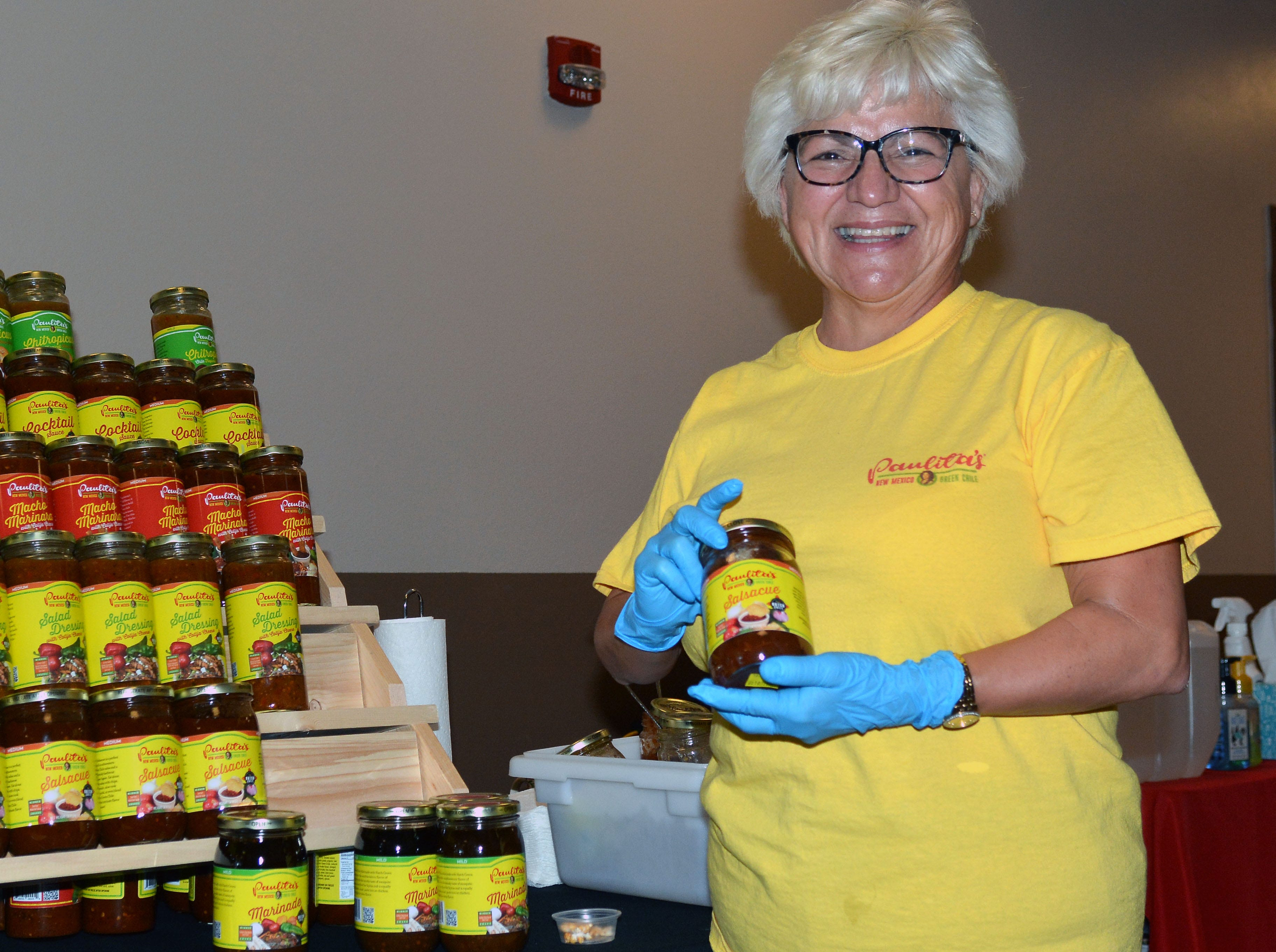 Paula Porter of Paulita's poses with her most popular salsa.  Photo taken 11/17/18.
